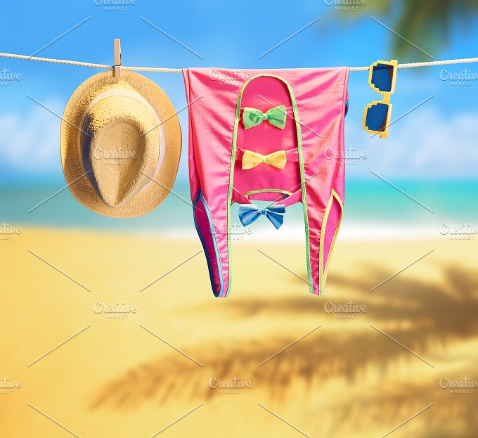 Beach outfit. Summer clothes set on tropical sea - Beauty & Fashion