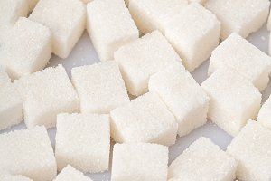 White sweet sugar cubes background