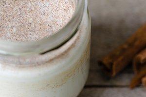 Cinnamon yogurt, rustic background.