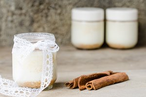 Cinnamon yogurt, rustic background.