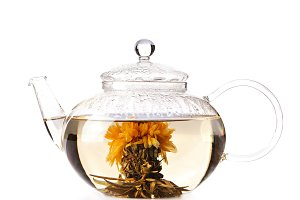 Teapot with green herbal tea isolated