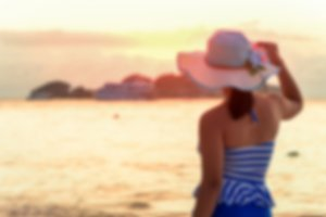 Girl on the beach at sunrise