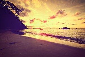 Vintage beach at sunrise