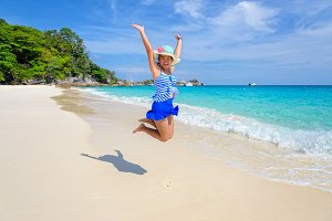 Young girl jumping on beach