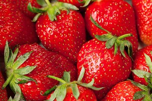 Fresh red strawberries closeup backg