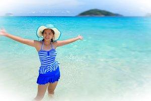 Girl happy on the beach