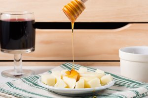 Pouring honey on cheese