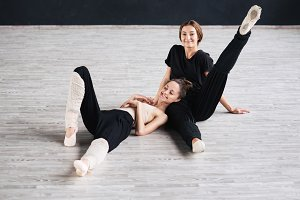 two dancers friends practice in dance studio