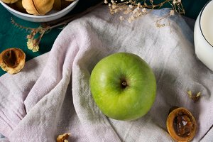 Green apple on napkin
