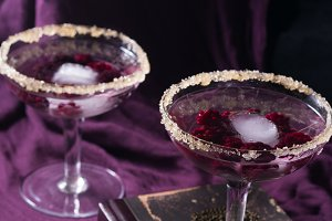Two cocktails on purple