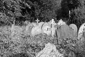 Tombs and crosses at goth cemetery in black and white