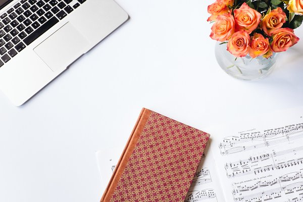 Book, flowers and sheet music