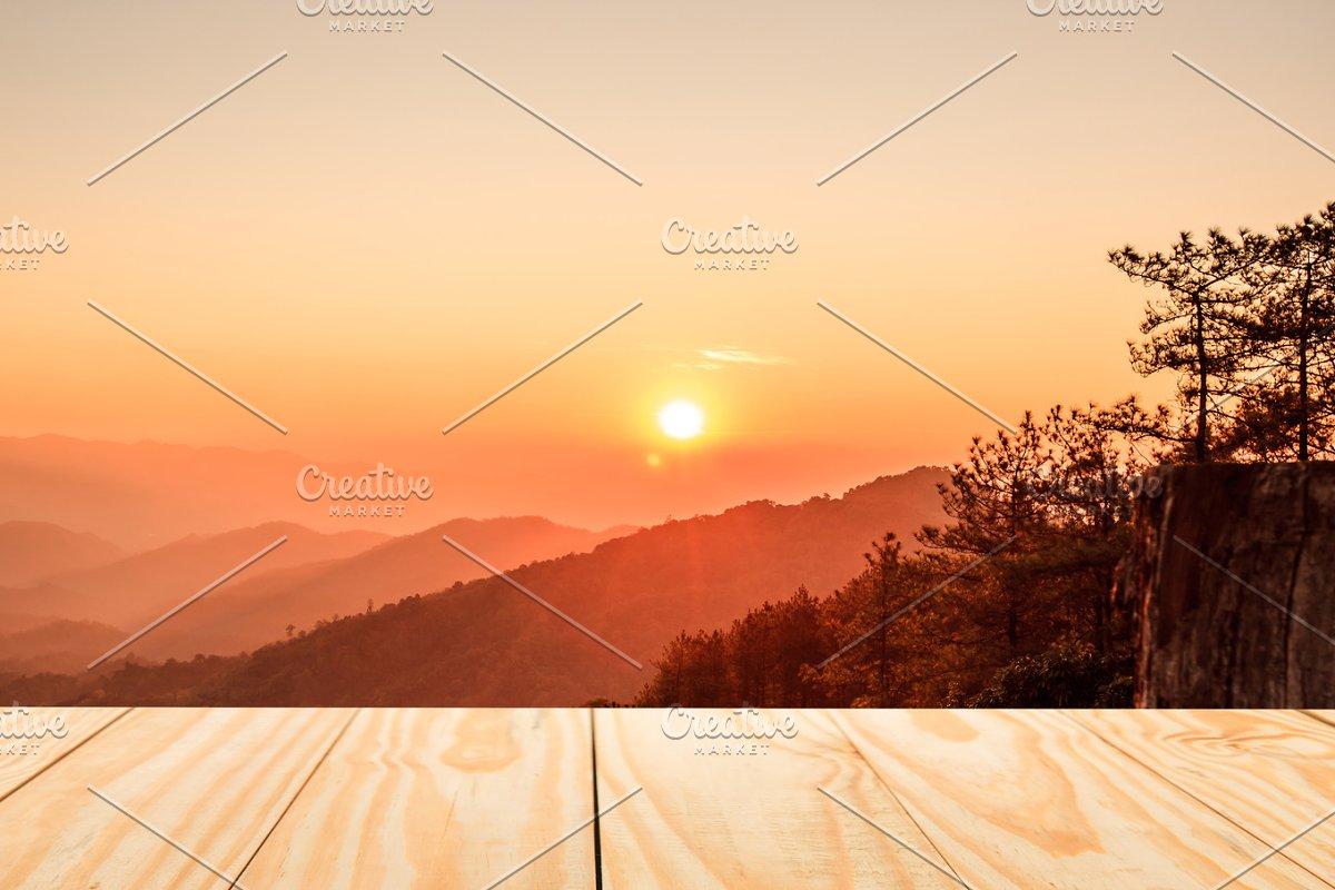 Empty wood table on sunrise