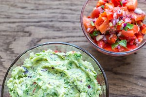 Bowls of guacamole and salsa