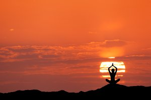 Silhouette of a girl practicing yoga