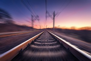 Railway station in motion at sunset
