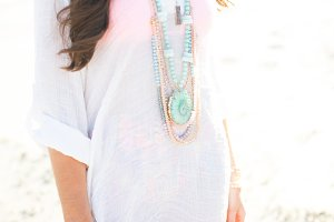 Brunette Smiling and Styling Jewelry