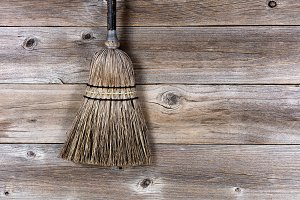 Vintage broom on stressed wood