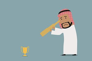 Arabian businessman looking at prize