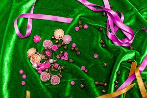 Buttons and ribbons on fabric