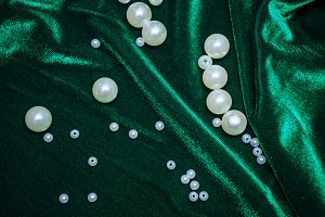 Pearls on fabric shot closeup