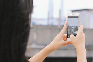 Kid taking photo on smartphone