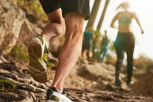 Male runner on rough terrain