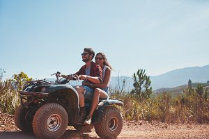 Couple riding on a quad bike