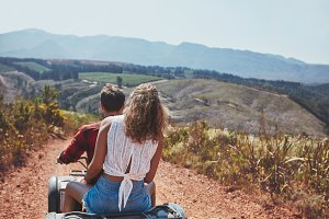 Young couple riding on a quad bike