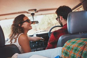 Young couple enjoying a road trip