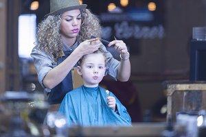 Boy cutting hair at barber shop
