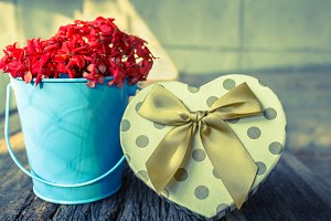 Heart shaped gift box with flower.