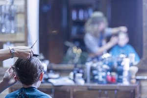 Boy cutting hair at barber shop