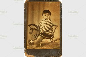 child on a toy horse