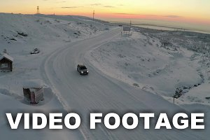 Aerial view of car driving snowy