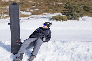 Man with snowboard at ski resortr