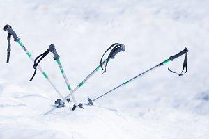 Ski poles in white snow.Background