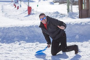 Young man playing at ski resort