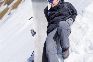 Man with snowboard at ski resortr