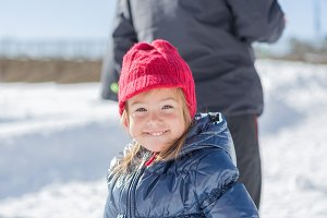 Portrait of little girl at snow
