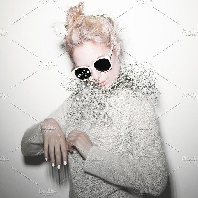 fashion woman portrait. Sunglasses Hippi hair flowers on face - Beauty & Fashion