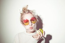 portrait of cheerful blonde hipster girl going crazy making funny face