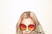 fashion woman portrait. Sunglasses Hippi hair flowers on face