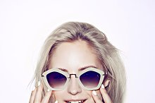fashion woman portrait. Sunglasses Hippie hair flowers on face