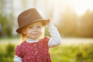 Portrait of cute little girl in hat