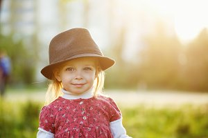 Funny cute little girl in hat