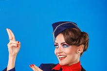 Stewardess shows arms up.