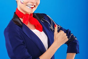 Stewardess shows thumb up.