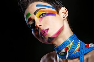 Stylist with face art. High fashion.