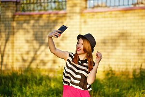 Lovely girl in hat makes Selfei